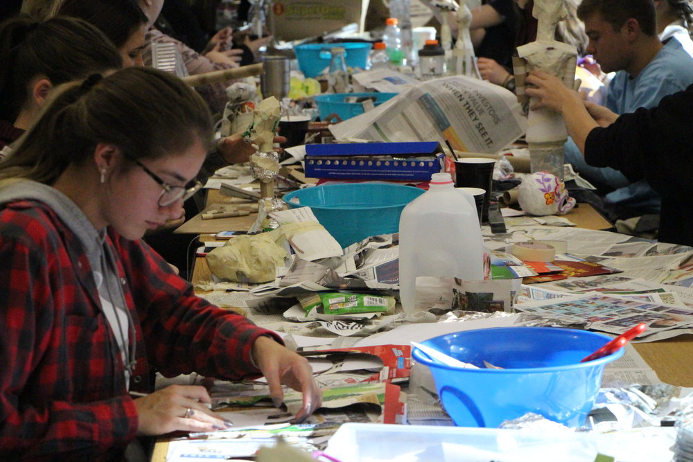 Chelsea Mason, a sophomore, working on her piece for the class ofrenda. Photo by Jakob Bermas