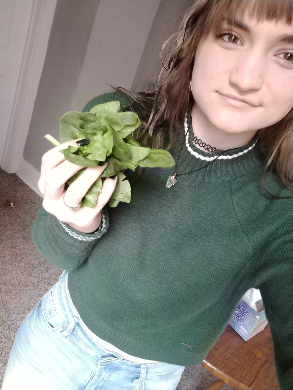 Marissa Stifter, one of the six members of Lettuce Club, with another one of her favorite green vegetables, spinach. Stifter has been helping Andrew Weisz restart the club to help with his stress over it. Photo courtesy of Marissa Stifter