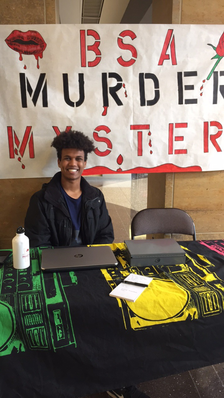 """Ahmed Mohammed, a member of BSA, tabling in Kirby and selling tickets for the Murder Mystery event on Oct. 29, 2018. Mohammed says to """"be comfortable and come have fun."""" Photo by Brianna Taggart"""