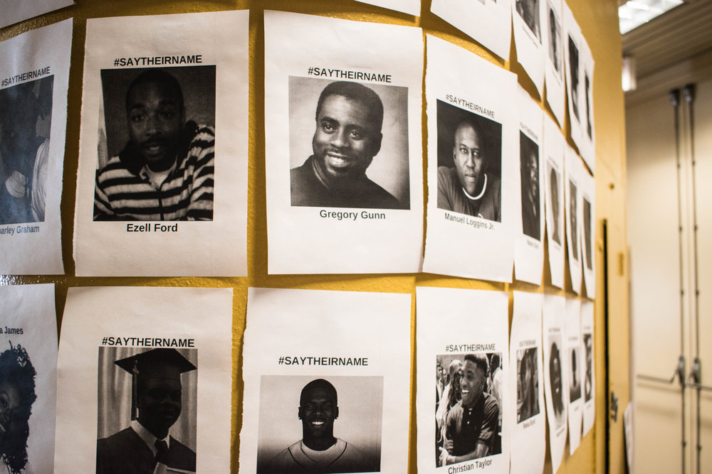 Posters showing victims of police brutality are displayed around the Multicultural Center. Photo by Karli Kruse