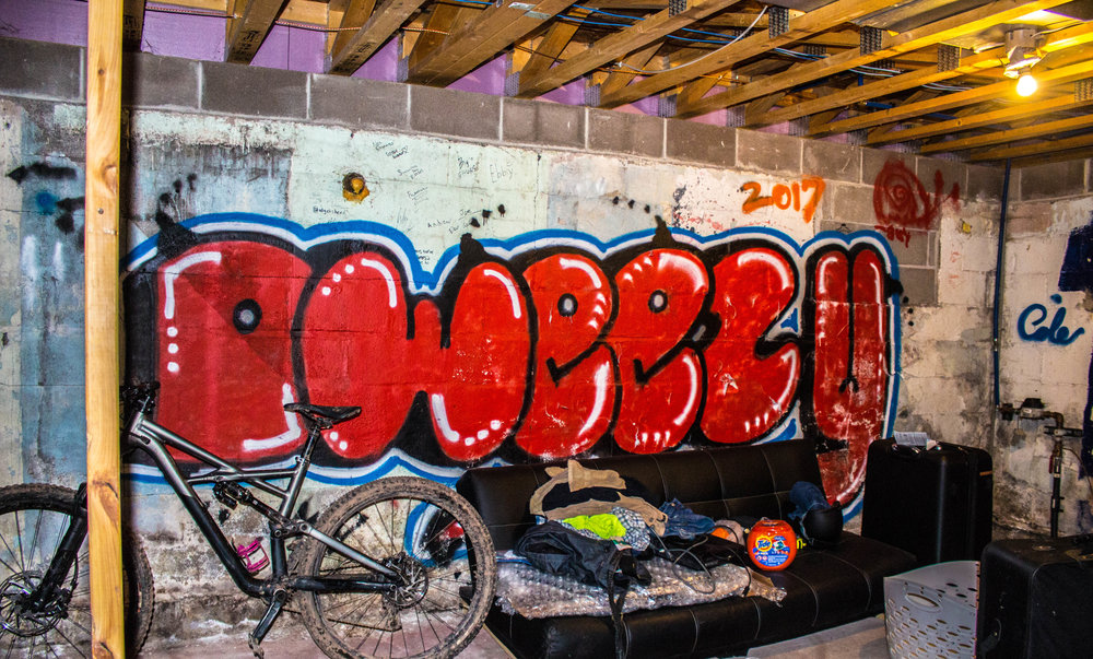 """Dwyer's nickname, """"Dweezy,"""" spray painted in a friends basement. Photo by Justin Flesher"""