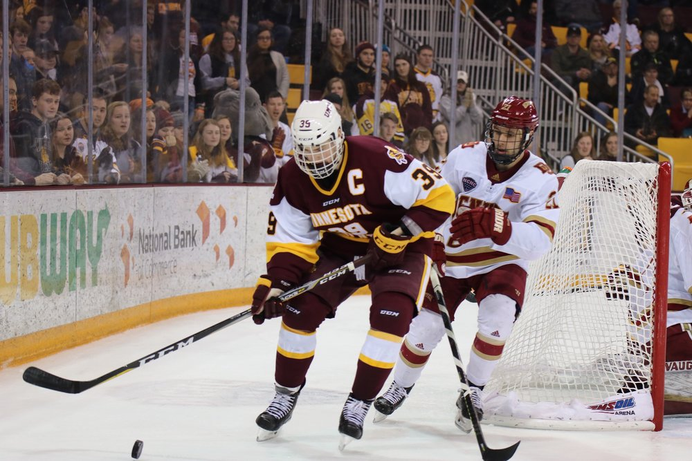 Parker Mackay (39) controls the puck behind Denver's net Saturday night. Photo by Drew Smith