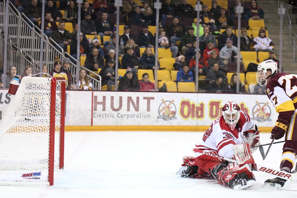Riley Tufte (27) watches as his shot goes past the goalie for a goal in the first period. Photo by: Drew Smith