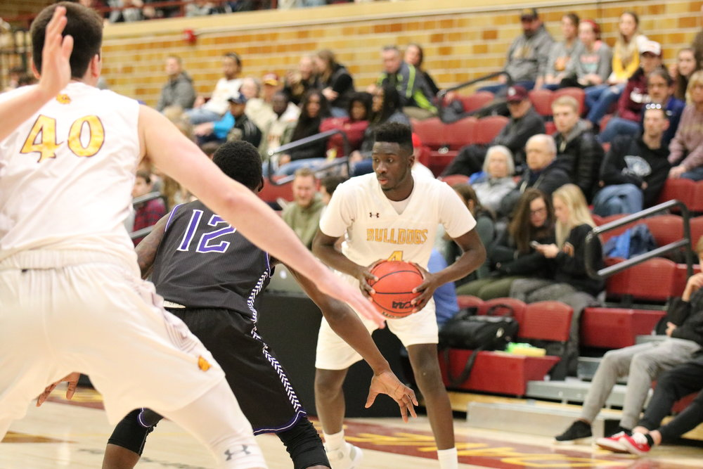 Senior guard Mamadou Ngom looks to make his move against Winona State defender. Photo by Drew Smith