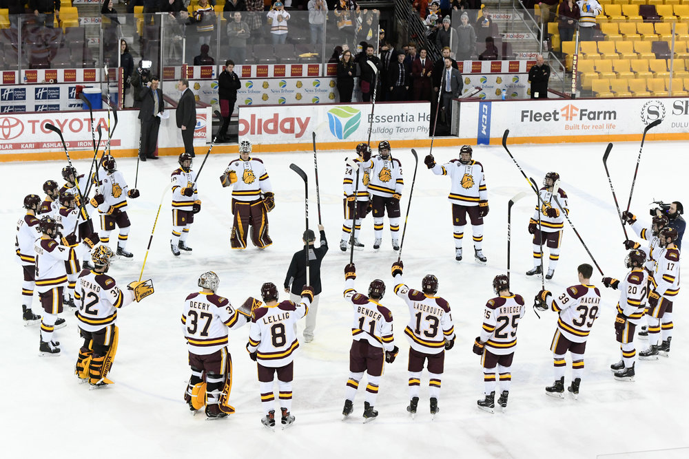 Bulldogs meet at center ice to commemorate their sweep. Photo by: Therese Norton