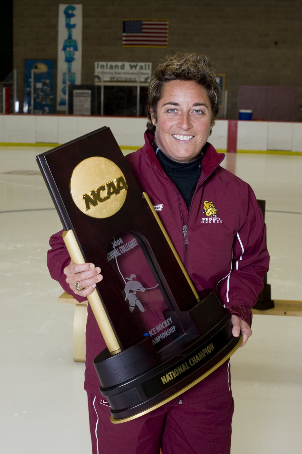 Former UMD women's hockey coach, Shannon Miller holding a National Championship trophy after UMD won in 2008. Photo courtesy UMD Athletics