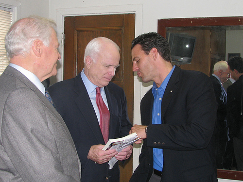 Asking Arizona Senator John McCain for an autograph