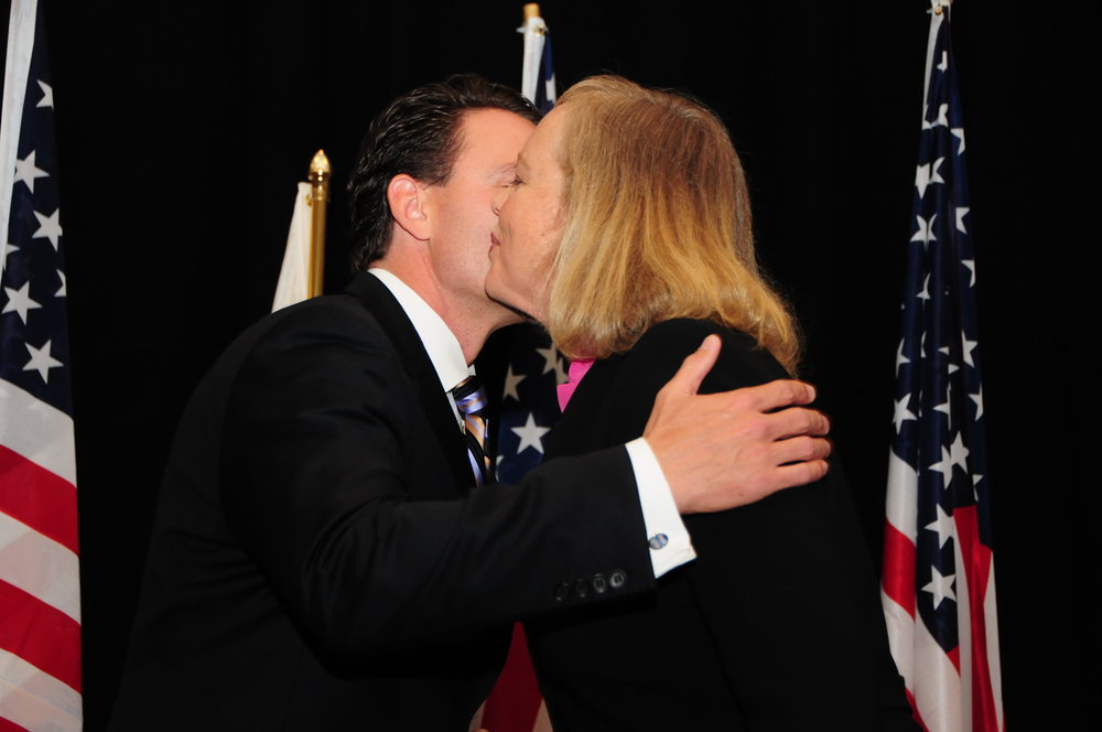 Kissing up to Republican Meg Whitman