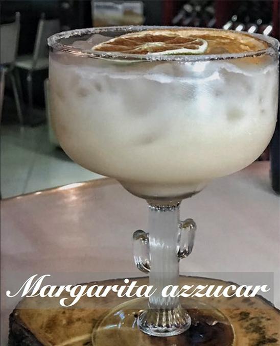 Ingredientes - • 2oz. de tequila• 1/2oz. Grand Marnier• 1oz. jugo de limón fresco• 1oz. sirope de jengibre• 1oz. crema de coco