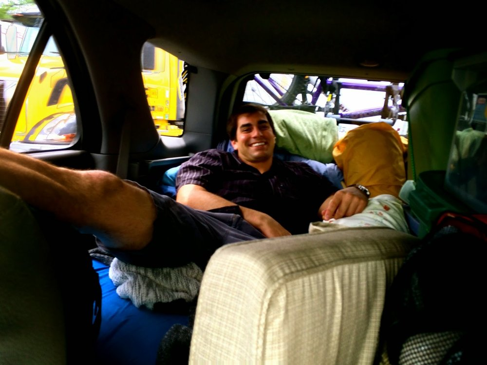 Brad enjoying our luxurious lounge in the backseat. Very, very cozy for stretching out, reading, and/or sleeping.