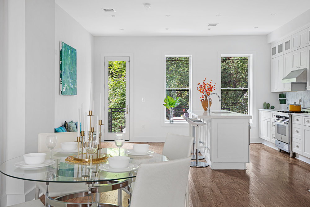 Pulling the outside in, this classic floor through parlor is quintessential townhouse, Brooklyn.