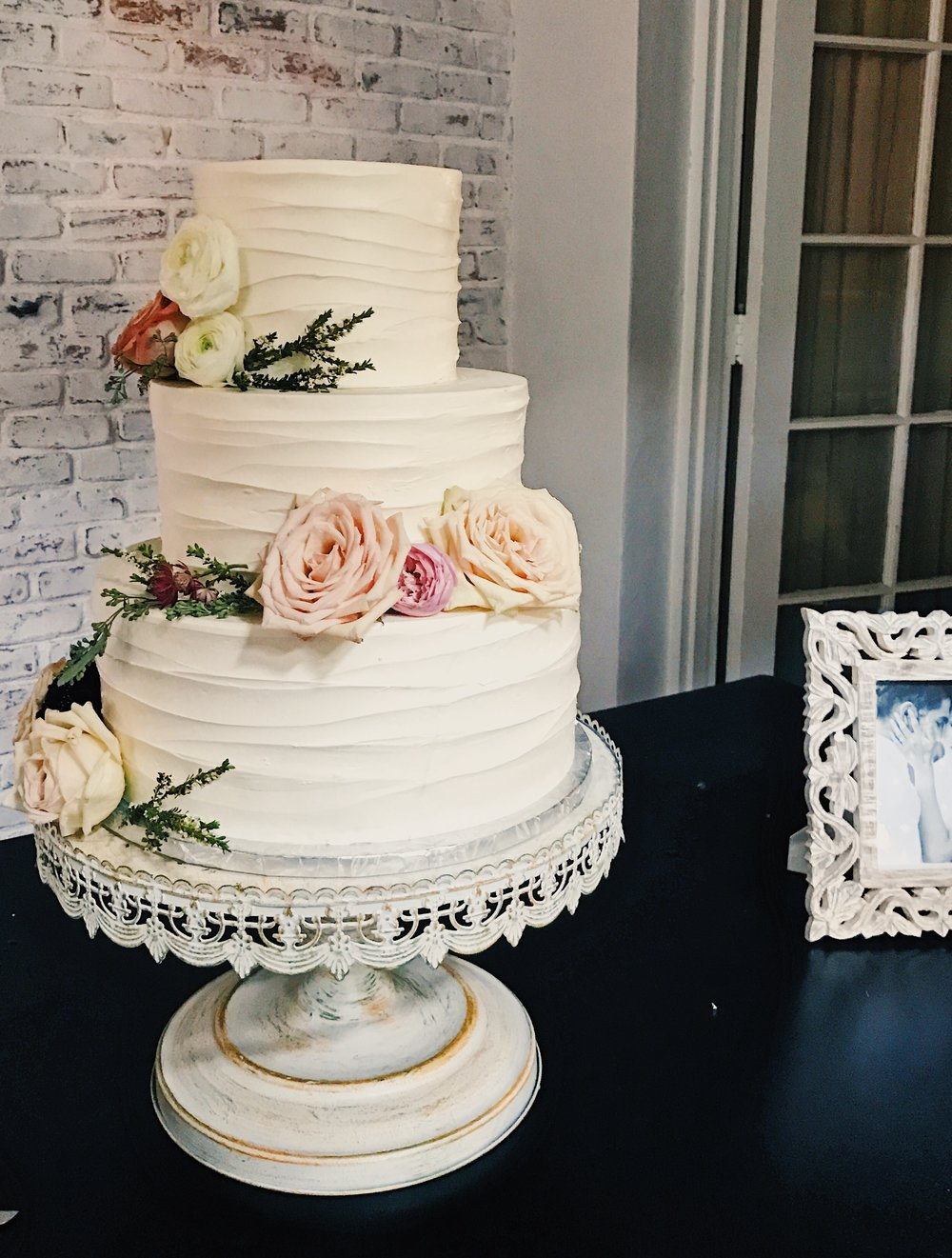 top tier of wedding cake for christening layer cake bakery 21069