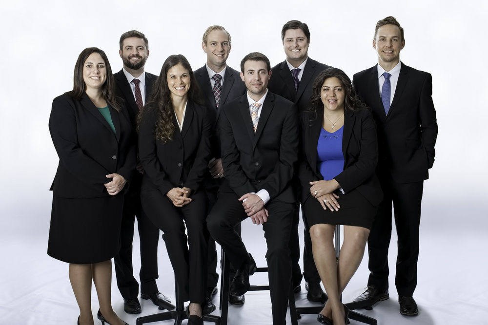 Meet our First-Year Residents - Standing (left to right): Lindsey Waldron, D.O., Michael Armstrong, M.D., Shelby Steffen, M.D., Josh Larson, M.D., Kyle Gibbens, M.D., Alex McDonald, D.O., Catherine Youssef, M.D. Spencer Steffen, M.D.