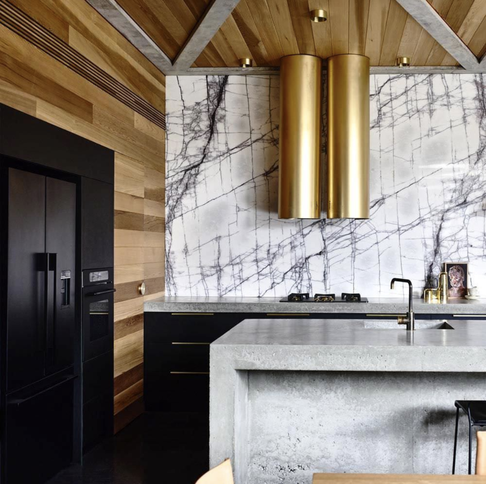 Source . Kitchen hood done right! This whole space is absolutely stunning.