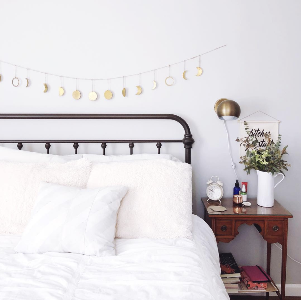Source . Have you met my friend Sarah from @_thegrandapt? This moon phase hanging over her bed is gorgeous and sounds like a wind chime in person.