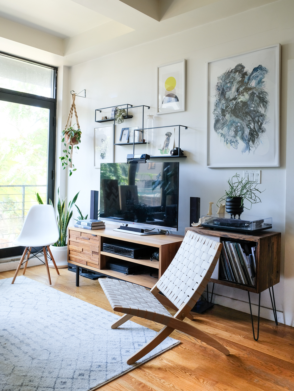 Decorating around a TV is always challenging, but gallery wall is a nice way for it to blend in.