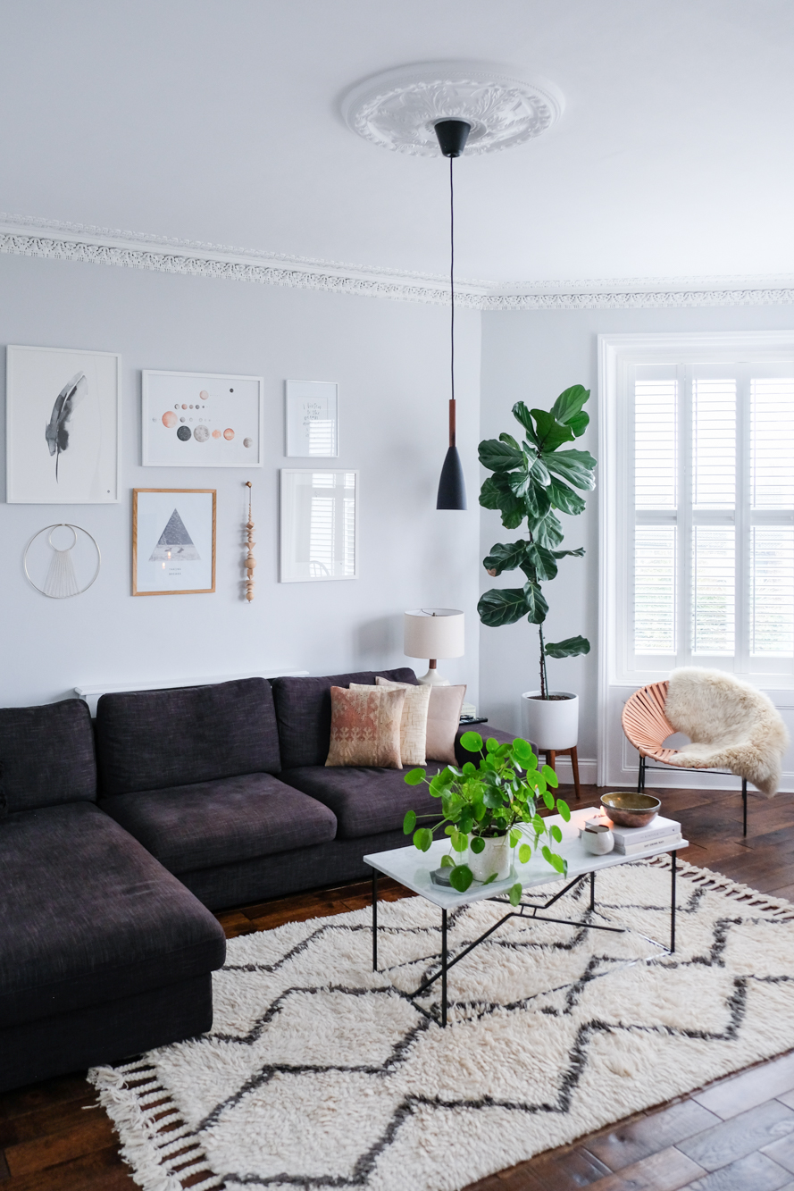 Kelly's living room featured gorgeous molding, gallery wall styled to perfection, and my new favorite pendant light.