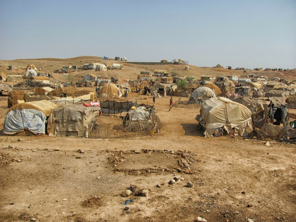 "![alt text](/path/img.jpg ""refugee camps in eritrea-105081_1920.jpg"")"
