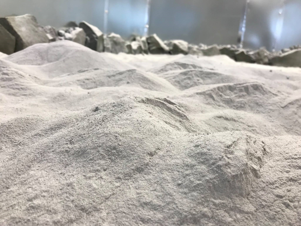 - This image shows a close-up view of the OPRH2N highland regolith simulant that is being placed into the Lunar Surface Simulation Lab. When complete, the lab will hold over 30 tons of simulant.