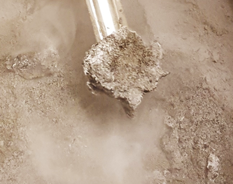 OPRFLCROSS1 frozen into Lunar Highland Regolith Simulant - This picture is from our initial experiment in February, 2018 which demonstrated our ability to simulate lunar ice; what is shown is one of our lunar Highland simulants in which lunar ice has been frozen.  The north and south poles of the Moon are predominantly Highland regions.