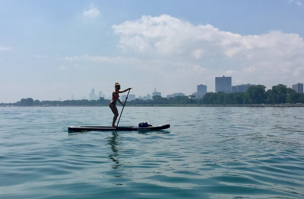 Paddling the waters near Montrose Beach