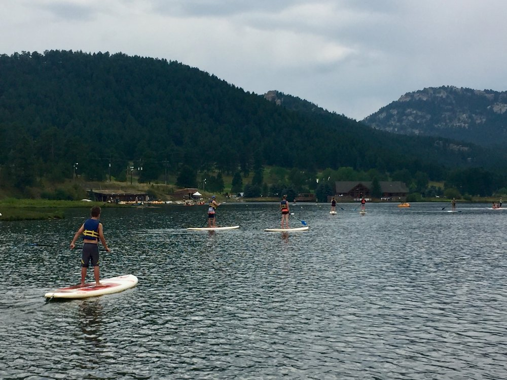 Paddle boarders on Evergreen Lake