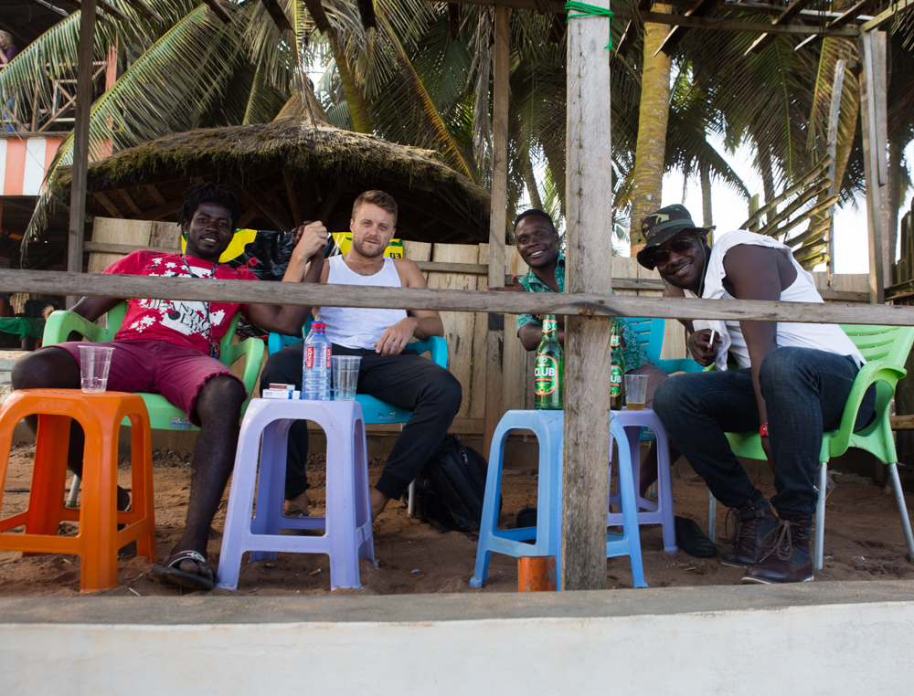 Drinks on the beach with new friends in Cape Coast, Ghana.