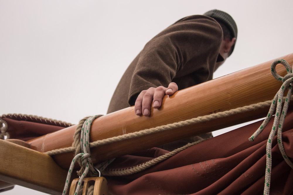 Enzo Cilenti at sea wearing UNITE cologne for men by Thomas Clipper