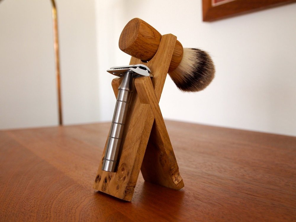 Stand shown with Anniversary Brush and Mark One razor (not included)