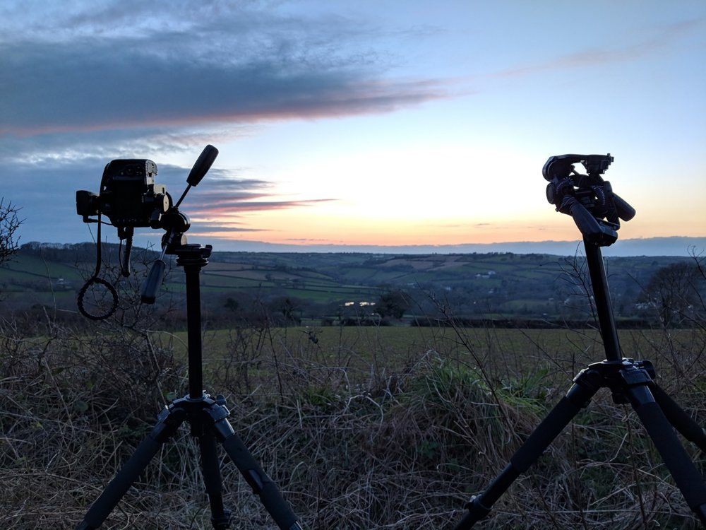 Two cameras enjoying a sunset and some good beer, or a late-night photoshoot? I'll let you decide.