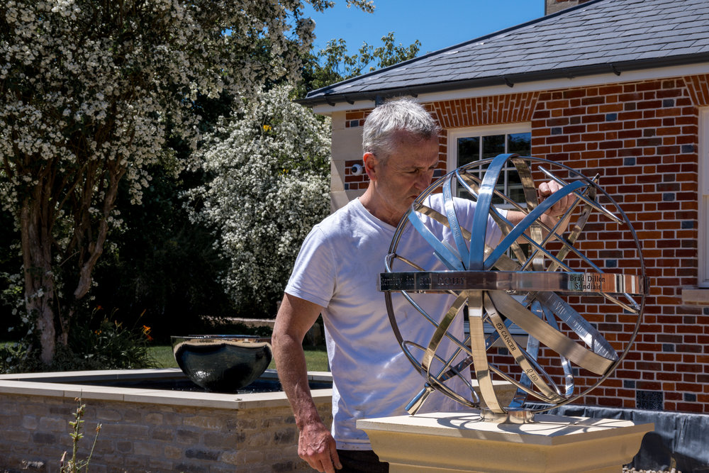 Brad Dillon inspecting his armillary sundial, that's been installed in a home in Wiltshire.