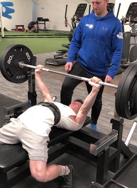 Harry on the bench press with head coach Rob Murray