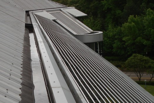Repair to Guttering and Roof lights. -