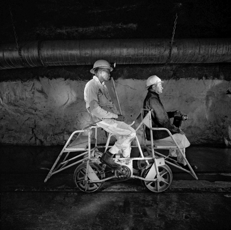 Team leader and mine captain on a pedal car, Rustenburg Platinum Mine, Rustenburg, 1971