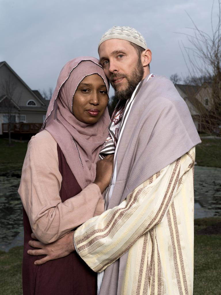 Kamilah Munirah Bolling and Adil Justin Cole stand outside their home in Farmington Hills, Michigan. by WAYNE LAWRENCE