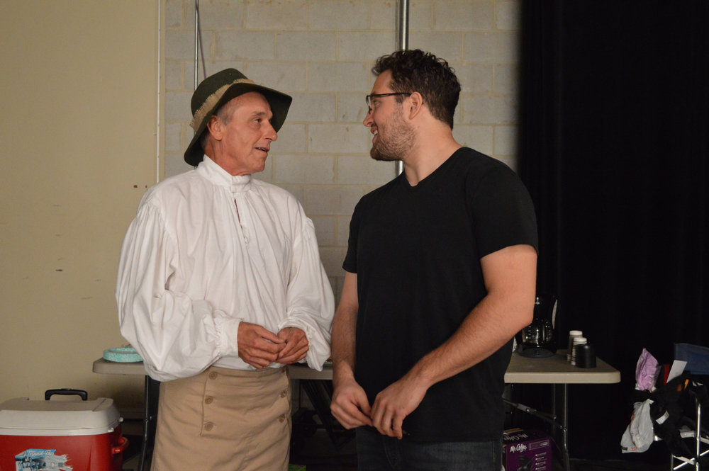 Actor Robin Robertson (left) dressed for one of his 7 roles, talking to Director Michael Duni (right).jpg