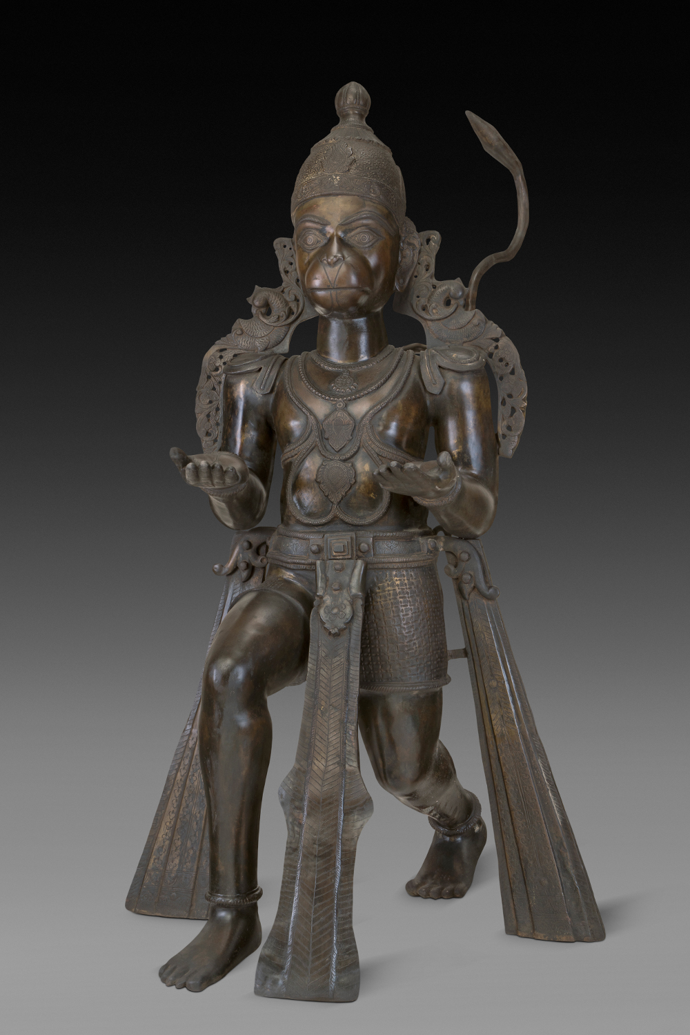 Hanuman - BronzeProbably 20th centuryAndhra Pradesh, IndiaCrafts MuseumHanuman is a monkey or vanara (forest being) who aided Rama – the fifth incarnation of Vishnu and the hero of the epic Ramayana. He was possessed of supernatural strength, steadfast loyalty and bravery, and is usually depicted as partly human. His example provides one reason why celibacy (brahmacharya) is admired and considered an aide to physical prowess and mental strength. Hanuman remains one of the most popular deities of Hindu worship and is the patron deity of traditional Indian gymnasiums or akhadhas.