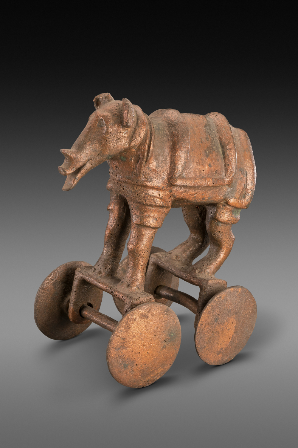 Rhinoceros - Bronze1500–1050 BCDaimabad, Maharashtra, IndiaNational Museum, New Delhi                       This copper cart is one of a set of four, the others are modelled into an elephant, buffalo and a chariot drawn by two bullocks. These carts are too small to be visible to the public in a procession and too heavy to be used as toys. They are most likely expensive grave goods or ceremonial replicas. This rhinoceros bears some similarities with depictions on Harappan seals. Yet no major Harappan-style cities have been found in Maharashtra.