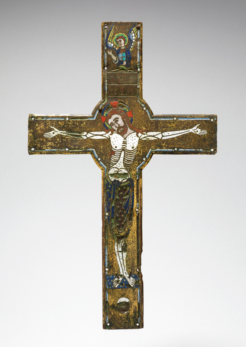Crucifix  - CopperAbout AD 1190Limoges, FranceBritish Museum The crucifix is the most recognisable symbol of Christianity. It is a representation of the crucifixion of Jesus Christ, the son of god, who is believed to have died for the salvation of humanity. This crucifix would have acted as a focal point for worship. It shows the body of Christ in white looking cadaverous. His face, however, is not leached of colour, and his eyes remain open indicating that he remains unconquered by death.
