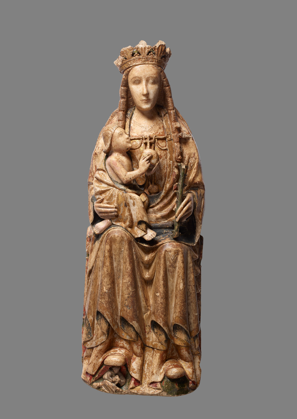 Virgin and Child - AlabasterAD 1450–1499United KingdomBritish Museum                        Catholics believe the Virgin Mary is the mother of Jesus, and therefore the mother of god. Mary's role is to offer compassion and intercede on behalf of those who pray to her. This Virgin, crowned and enthroned, holds in her right arm the figure of Christ. He gazes lovingly at the face of his mother, while she directs her gaze to the onlooker.The large size of this figure suggests that it occupied a prominent space in a church.