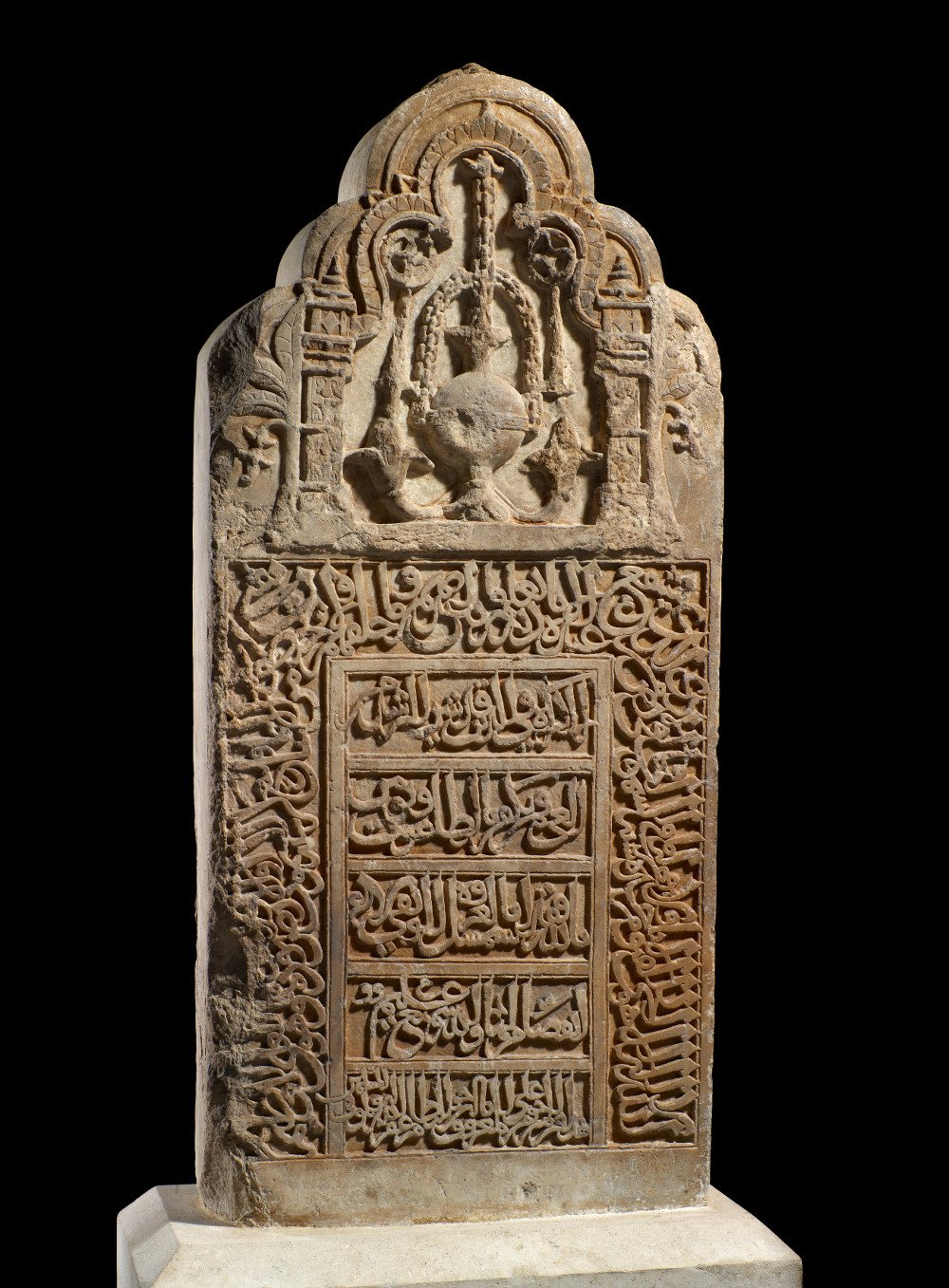 Islamic gravestone  - MarbleAD 1400-99Probably made in Cambay, India; found in Aden, YemenBritish Museum, donated by Messrs Newman, Hunt & Christopher This gravestone in the shape of a prayer niche was found 3,000 kilometres away from where it was made. It was initially carved in the port city of Cambay in Gujarat and possibly personalised later in Yemen with the name of the deceased: Abu'l-Hassan. Indian-produced tombstones were desirable to Muslims from as far away as the Arabian Peninsula, East Africa and Indonesia. Long journeys across the Indian Ocean meant gravestones could take months or even years to arrive.