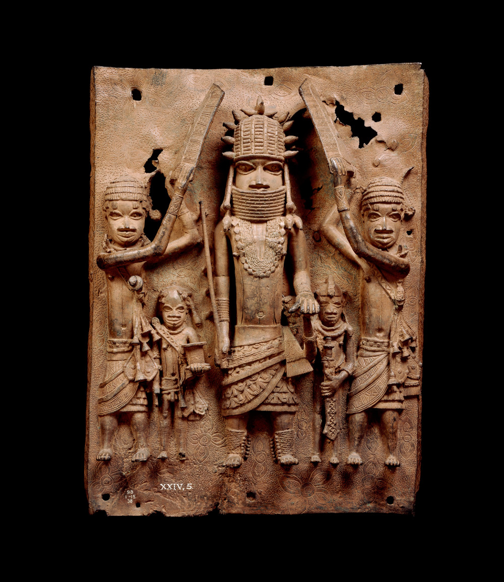 Benin plaque - BrassAD 1550–1650Benin City, NigeriaBritish Museum The Kingdom of Benin, in modern-day Nigeria, reached the height of its power in the late 1500s. Its capital in Benin City was ruled by an Oba (king), regarded as the Edo people's highest spiritual and political authority. The Oba was also the head of government.On this plaque, the Oba stands in the centre surrounded by four attendants. The textured cloth around his waist may represent imported Indian fabric, which was brought to West Africa by Portuguese traders.