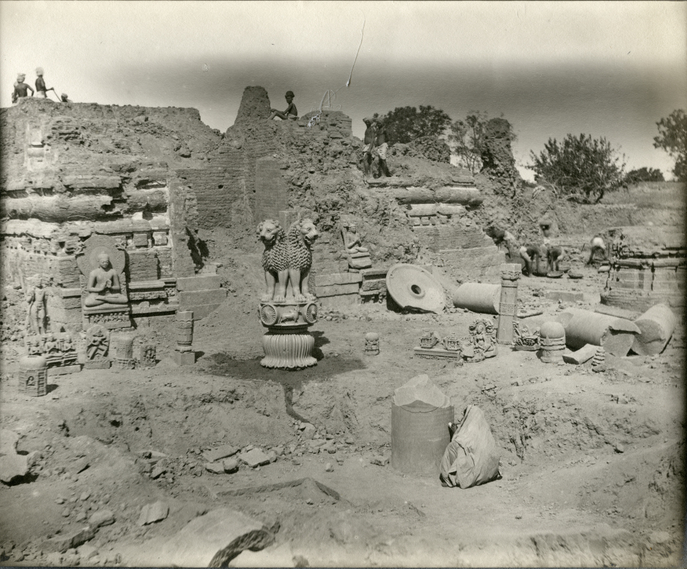 View of excavations west of the main Buddhist shrine, Sarnath, showing Lion Capital of Ashoka Pillar found in March 1905  - Photograph by Frederick OertelSilver Gelatin PrintMuseum of Archaeology and Anthropology, Cambridge The Archaeological Survey of India was established in 1861 by Alexander Cunningham, who led excavations at famous Indian Buddhist sites like Sarnath, Bodh Gaya and Bharhut. These two evocative photographs capture the rediscovery of India's ancient history against the backdrop of British colonial rule. One is of an Indian touching a relic of his ancient past and comes from a commercial album. The other, by Frederick Oertel, was taken when he excavated the Lion Capital at Sarnath in 1905. In the years after these photographs were taken, the Sarnath Lion Capital went on to be adopted as the symbol of the new Republic of India.