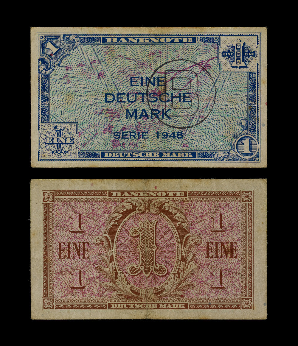 West and East German Banknotes - One markPaperAD 1948Berlin, GermanyBritish MuseumAfter World War II, Germany was partitioned into West and East. Initially, Britain, France and the USA controlled the West, while the Soviet Union controlled the East. These one mark banknotes were both created in 1948 and were the first currencies issued by the two new countries. West Germany, led by the USA, was the first to introduce a new currency. This took the Soviets by surprise – since 1946 all parties had, in theory, been working towards a unilateral currency reform. In response, the Soviets hastily introduced a rival currency, the Ostmark ('East-mark'), but were nevertheless highly critical of the USA's decision, announcing that it 'completes the division of Germany'.