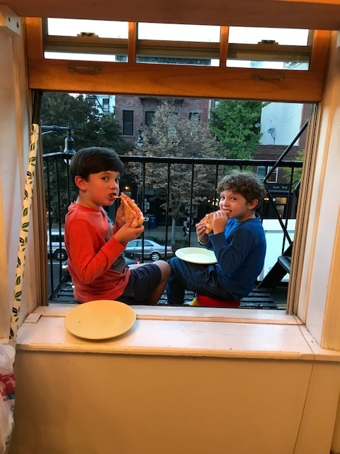No massive backyard, BUT you can eat pizza out of a fire escape!