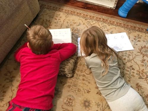 homeschool+handwriting+on the floor+siblings+working together.jpg