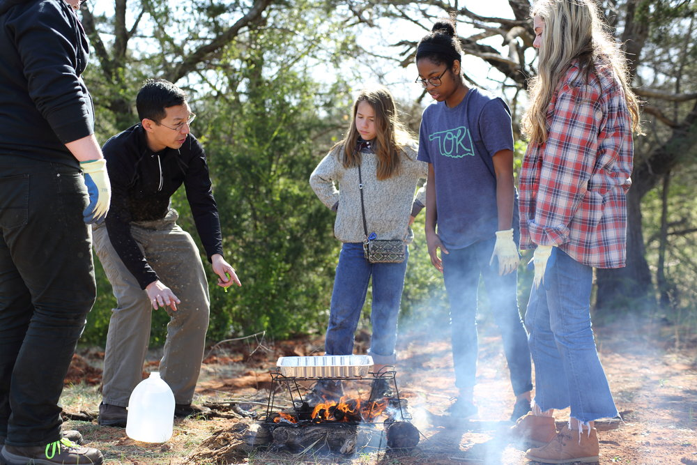 Energy students generate fire to boil water as they learn about fuels and natural energy sources.