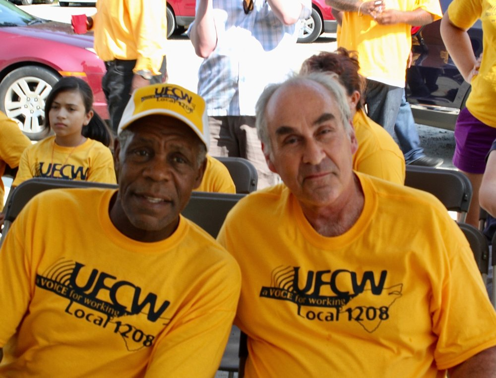 Danny Glover with Matt Barr in Tar Heel, NC, visiting UFCW Local 1208 members in 2013.