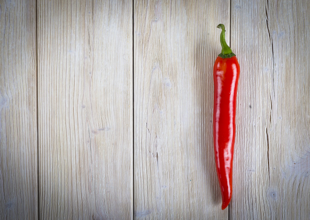 red-chili-pepper-on-rustic-wooden-background-PYW9MAV.jpg