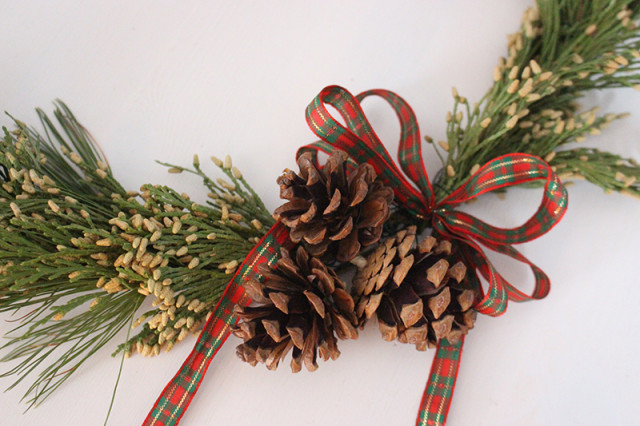brass-ring-christmas-wreath-pinecones-ribbon-640x426.jpg